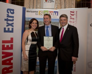 "Conor Power (centre) receiving the award in the ""Sun Holiday"" category at the Travel Extra Travel Writer of the Year awards in Dublin, January 2016"